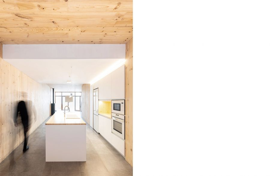 CLT house between party walls